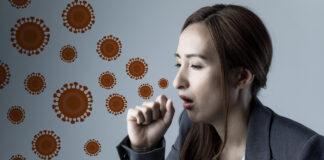 Ilustracja kobiety roznoszącej wirusa przez kaszel